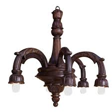 hand carved victorian style wood chandelier with downward lights circa 1910 for