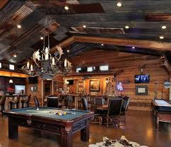 office man cave ideas. Tin Panel Roofing And Animal Antlers Chandeliers Over The Pool Table. Office Man Cave Ideas