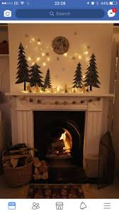 What a beautiful hearth - lights, evergreen trees, fire.I love it!