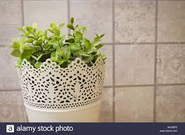 office flower pots. Artificial Green Plants In White Metal Flower Pots For Home And Office Decoration Without The Care. A