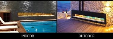 an indoor outdoor fireplace doubling its functionality and extending its impact get warmth and ambience inside and outside with our clear 130 tunnel