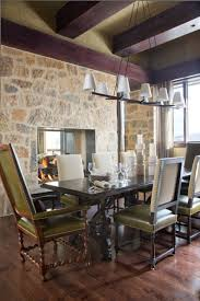 top 69 dandy rectangular dining table in cozy rustic room design with linear chandelier and interior stone wall also upholstered chairs dark wood floors two