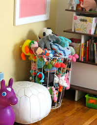 Isn't this toy canopy a gorgeous option for a girl's room? It looks so  wispy and pretty. Stuffed Animal Storage Ideas to Minimize Toy Clutter