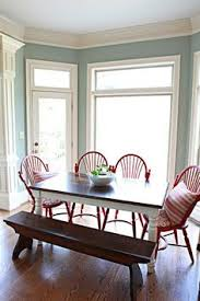 love the white and brown table with the red chairs possibly the same for my kitchen table like the red accent in chairs also like the blue walls for my