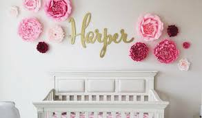 giant paper flowers wall collage pink paper wall flowers with gold custom wood name sign on flower wall art for nursery with tips for designing your nursery with paper flowers caden lane