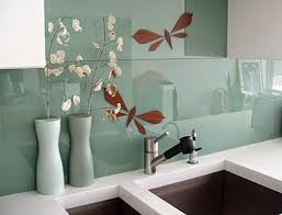 light up the glass wall tiles with light colors like yellow green cream milky white etc to get the stunning effects on the glass wall