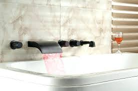 roman bathtub faucet image of waterfall delta repair faucets with handheld shower wate