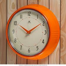 infinity wall clock. orange fifties-style kitchen wall clock | infinity clocks for
