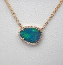 yellow gold black opal with diamond halo pendant