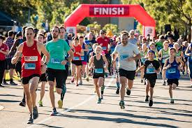 Families warming up for the Griffith Sport Logan Fun Run on Sunday 9 June –  Griffith News
