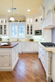 white kitchen dark wood floor. Fabulous White Kitchen Cabinets Wooden Floor Yellow Dark Wood