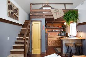 Designing a tiny house Couples Charming Tiny House With Wood Flooring And Stairs Treehugger Cozy Rustic Tiny House With Vintage Decor Idesignarch Interior