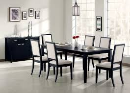 modern dining sets in black and white theme with rectangle dining table made of black wood combined with side dining chairs made of white upholstered and