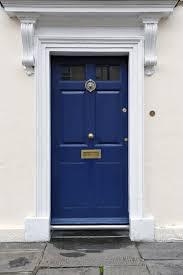 blue door house. The Main Entrance Has A White Concrete Facade. It Blue Door With House