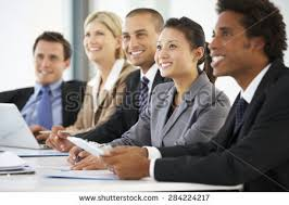 office meeting. Group Of Business People Listening To Colleague Addressing Office Meeting