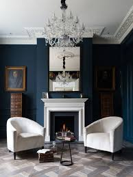 Ornate formal and enclosed living room photo in London with blue walls and  a standard fireplace