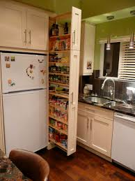 The narrow cabinet beside the fridge pulls out to reveal a spice ...