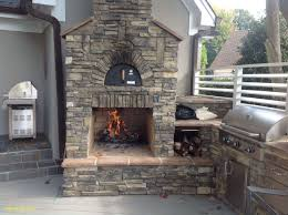 custom outdoor fireplace and pizza oven with an outdoor kitchen on a trex transcends gravel path