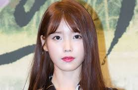 when iu first debuted on the scene she captured hearts with her cute y makeup and blunt bangs