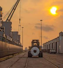 Image result for rolled steel on trucks from port of  brownsville
