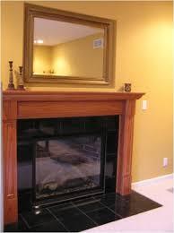 fireplace surround oak mantel granite tiles recessed mirror above fireplaces granite tile oak mantel and fireplace surrounds