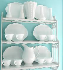 I love white dishes and I own many milk glass dishes and plain white dishes,  so instead of hiding them behind cabinet doors I decided to display them.