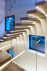 ultra modern lighting fixtures decorating floating oak staircase with led striped and glass stair railing oa