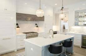 lighting trend. A Kitchen With White Cabinets, Island And Hanging Glass Pendant Lights Wall Lighting Trend