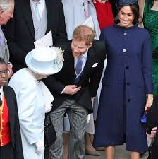 Meghan markle attended the wedding of princess eugenie and jack brooksbank in a classically elegant navy blue coat and matching dress. Meghan Markle And Prince Harry Had Moment With Queen Elizabeth Ii At Princess Eugenie S Wedding