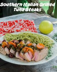 southern italian grilled tuna steaks are topped with the flavors of tomatoes lemon capers