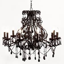 curving black chandelier with many lamps with candles shape completed with hanging ornaments
