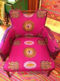 mid century club chairs reupholstered in purple african wax print fabrics
