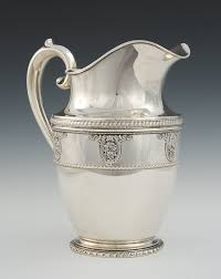 a sterling silver water pitcher in rose point pattern by wallace