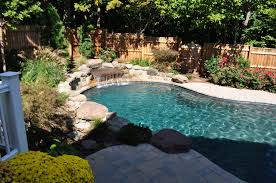 In ground pools with waterfalls Natural Stone Custom Inground Pool Water Feature Baltimore Md Johnson Pools Freeform Pool Waterfall Raised Stone Walls Baltimore Md