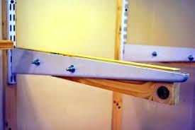 close up of finished bracket shelf track brackets closetmaid shelftrack 12