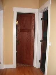stained door with white trim