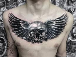 череп с крыльями татуировка на груди сделать тату у мастера вики