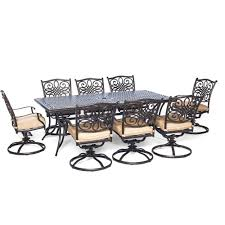 Traditions 9 piece aluminum rectangular patio outdoor dining set w eight swivel dining chairs and natural oat cushions