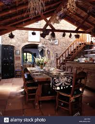 rustic spanish furniture. Rustic Wooden Table And Chairs In Dining Area Of Large Spanish Kitchen With Terracotta Tiled Floor Ceiling Beams Furniture Alamy