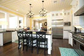 white kitchen cabinets with dark countertops white country kitchen with yellow painted walls chandeliers and black white kitchen cabinets with dark green