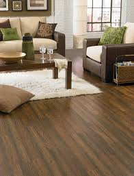 Long Lasting And Durable Laminate Wood Flooring Is Underfoot In This Living  Room.