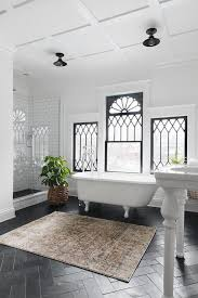 white french vintage style bathroom with black floor tiles