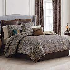 elegant patterned comforter king bed set and gray leather wingback