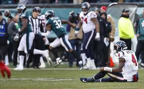 houston texans quarterback deshaun watson 4 sits on the field after giving up a