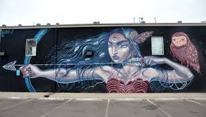 a new mural by lauren ys graces the wall of helikon gallery in rino