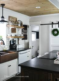 farmhouse kitchen with leathered granite counter tops