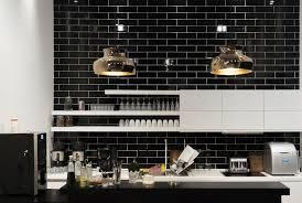 stunning pendant lighting room lights black. These Shiny Brass Lights Make A Stunning Statement Against The Black Subway Tile Of This Monochromatic Pendant Lighting Room