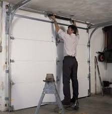 garage door maintenance tips the bottom brackets cables pulleys and springs are under