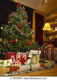stock photo toy train on track going around christmas tree fotosearch search stock