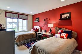 View in gallery Baseball themed kids' bedroom with a striking red accent  wall [Design: Deanna's Interior